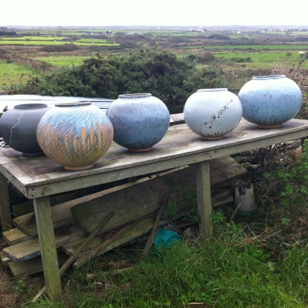 Adam's Moon Jars outside his studio