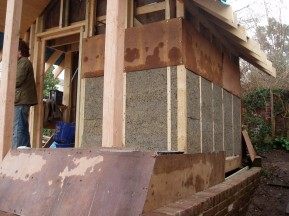 Timber frame construction with shuttering to hold / mould lime-hemp fill.