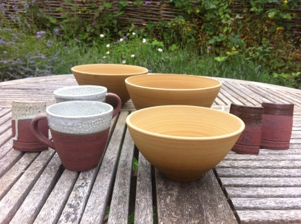 Clee Hill clay bowls drying alongside cups and test tiles fired to 1260 degrees....