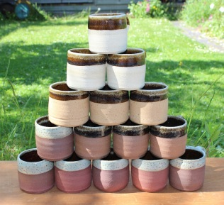 Stack of Clee Hill clay coffee mugs.
