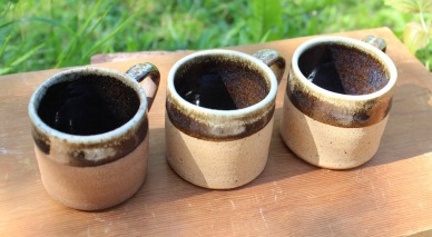 """Brick"" clay coffee mugs with chun effect dolerite glaze."
