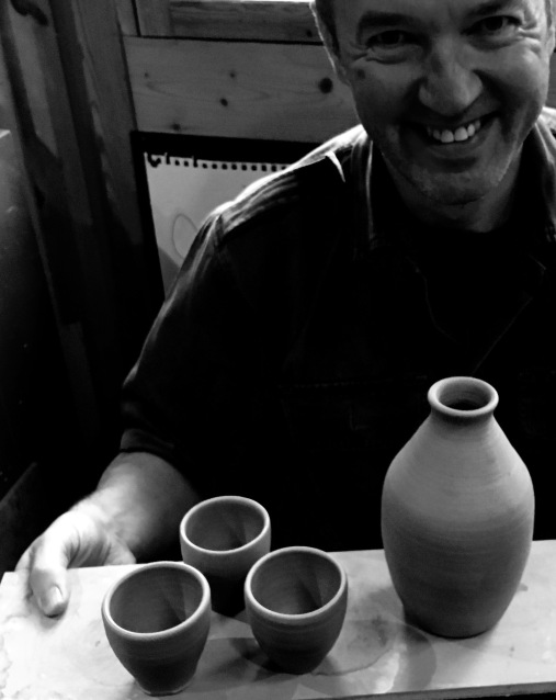 A very happy Ian with sake bottle and cups....